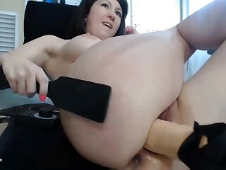 She is spreading her sexy legs and puts the big fat fucking machine inside her pussy